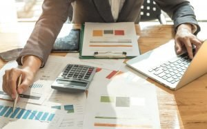 Business concepts,Men wearing suits are using a pen pointing on graph.