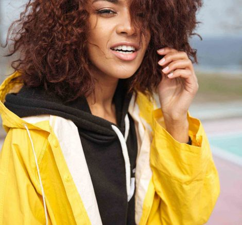 amazing-african-curly-young-woman-wearing-yellow-PCUMRSX-unsplash-scaled.jpg